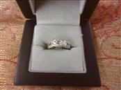 10K WHITE GOLD RING-THREE INTERLOCKING LOOPS WITH DIAMOND CHIPS SIZE: 4 3/4
